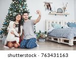 family gathered around a... | Shutterstock . vector #763431163