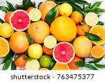 citrus fruits background.... | Shutterstock . vector #763475377