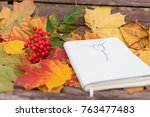 old notepad with drawing and... | Shutterstock . vector #763477483