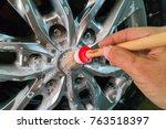 men's hands are cleaning wheels ... | Shutterstock . vector #763518397
