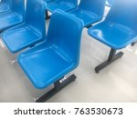 a roll of plastic blue chairs... | Shutterstock . vector #763530673