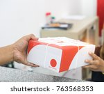 Small photo of male hand send mail envelope to the female of post office before sending .