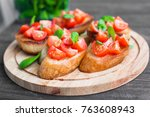 bruschetta with tomatoes and... | Shutterstock . vector #763608943