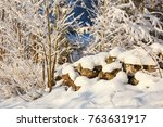 Snow Covered Stone Wall In...