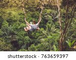 young tourist woman swinging on ... | Shutterstock . vector #763659397