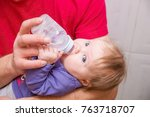 dad feeding baby from a bottle. | Shutterstock . vector #763718707