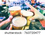 friend hands toasting beer... | Shutterstock . vector #763720477