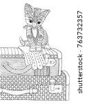 kitty traveler sitting on trunk.... | Shutterstock .eps vector #763732357
