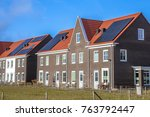 modern row houses with solar...   Shutterstock . vector #763792447