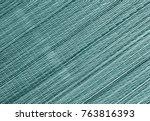 Cyan Toned Straw Mat Surface....