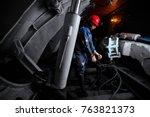 young miner works underground... | Shutterstock . vector #763821373