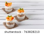 persimmon creamy trifle in... | Shutterstock . vector #763828213