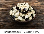 diced eggplants in a clay plate ... | Shutterstock . vector #763847497