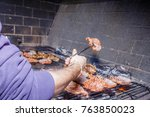 barbecue meat with a hand... | Shutterstock . vector #763850023