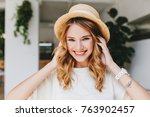 adorable laughing girl wearing... | Shutterstock . vector #763902457