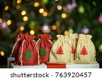 Red Ad Golden Pouches With...