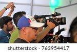 reporter taking video photo... | Shutterstock . vector #763954417