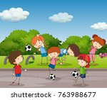 many kids playing football in... | Shutterstock .eps vector #763988677