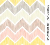 Seamless pattern. Chevron, a zigzag ornament. White, yellow, pink and gray colors. Pritn for textiles in doodle style. Vector illustration. | Shutterstock vector #764038537