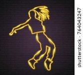 dance neon light glowing yellow ... | Shutterstock .eps vector #764043247