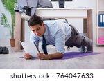 businessman doing sports in...   Shutterstock . vector #764047633