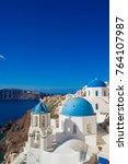 view on oia in santorini island ... | Shutterstock . vector #764107987