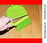 Small photo of brush to sweep the floor to remove the dust in the dustpan