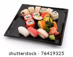 made dish of rolls and sushi - stock photo