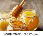 pouring aromatic honey into jar ... | Shutterstock . vector #764193367