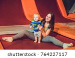 mother and her son jumping on a ...   Shutterstock . vector #764227117