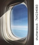 Small photo of Blue sky view from airplane window.
