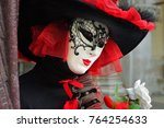 unidentified masked person in... | Shutterstock . vector #764254633
