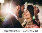handsome bearded indian groom... | Shutterstock . vector #764321713
