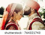 indian groom dressed in white... | Shutterstock . vector #764321743