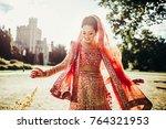 stunning indian bride dressed... | Shutterstock . vector #764321953