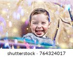 little happy boy laughs while... | Shutterstock . vector #764324017