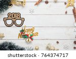 Small photo of Flat lay serial image of Happy new year 2018 & Merry Christmas background concept.DIY photo booth props & decorations holiday party home decor for winter season.items on white wooden at office desk