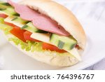 sandwich with ham and cheese  | Shutterstock . vector #764396767