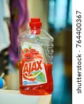 Small photo of POZNAN, POLAND - NOVEMBER 25, 2017: Ajax Floral Fiesta floor cleaning liquid in a opened bottle