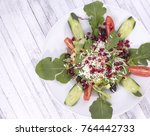 salad with pomegranate seeds... | Shutterstock . vector #764442733