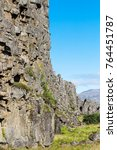 Small photo of travel to Iceland - stone walls of Almannagja Fault in Thingvellir national park in autumn