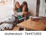 troubled young girl comforted... | Shutterstock . vector #764471803
