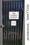 Small photo of Fire hydrant booster sign and cage
