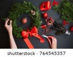 mom makes a christmas wreath... | Shutterstock . vector #764545357