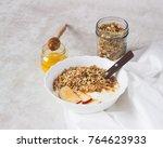 greek yogurt bowl with muesli ... | Shutterstock . vector #764623933