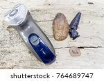 electric razor next to... | Shutterstock . vector #764689747
