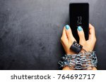 woman hands tied with metallic...