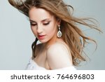beautiful young woman with... | Shutterstock . vector #764696803
