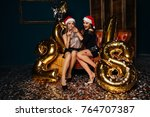 christmas eve. two cheerful...   Shutterstock . vector #764707387