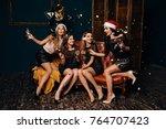 beautiful women in red... | Shutterstock . vector #764707423